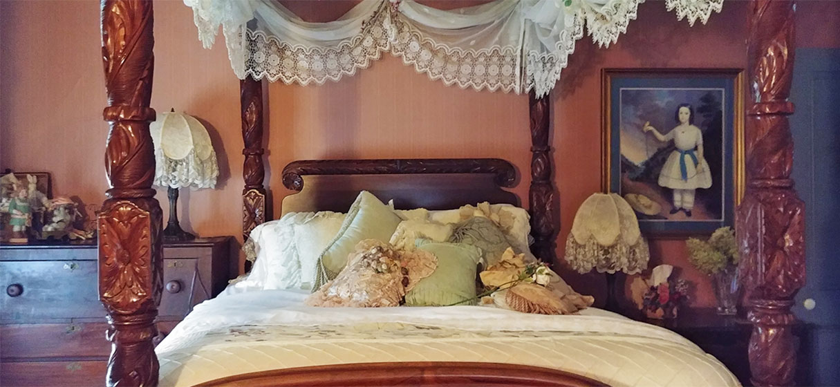 Bed with intricate posts
