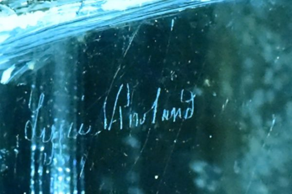 Lizzie Rowland signature etched in window